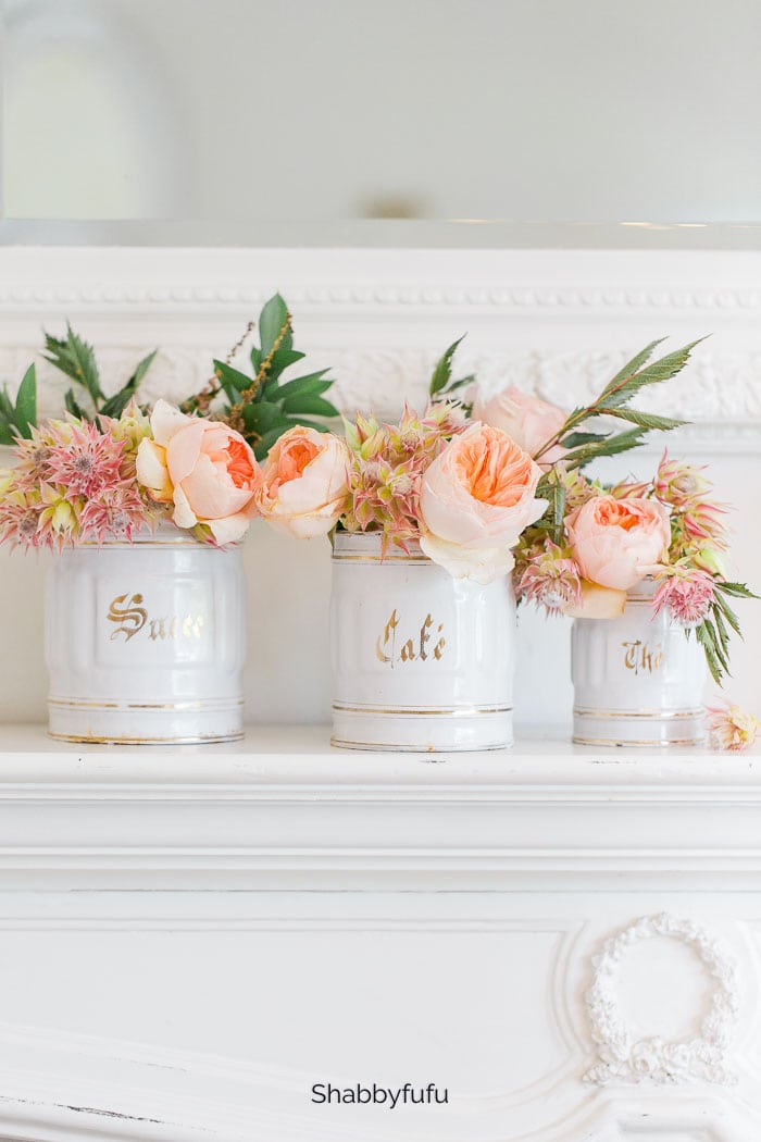vintage french canisters filled with flowers