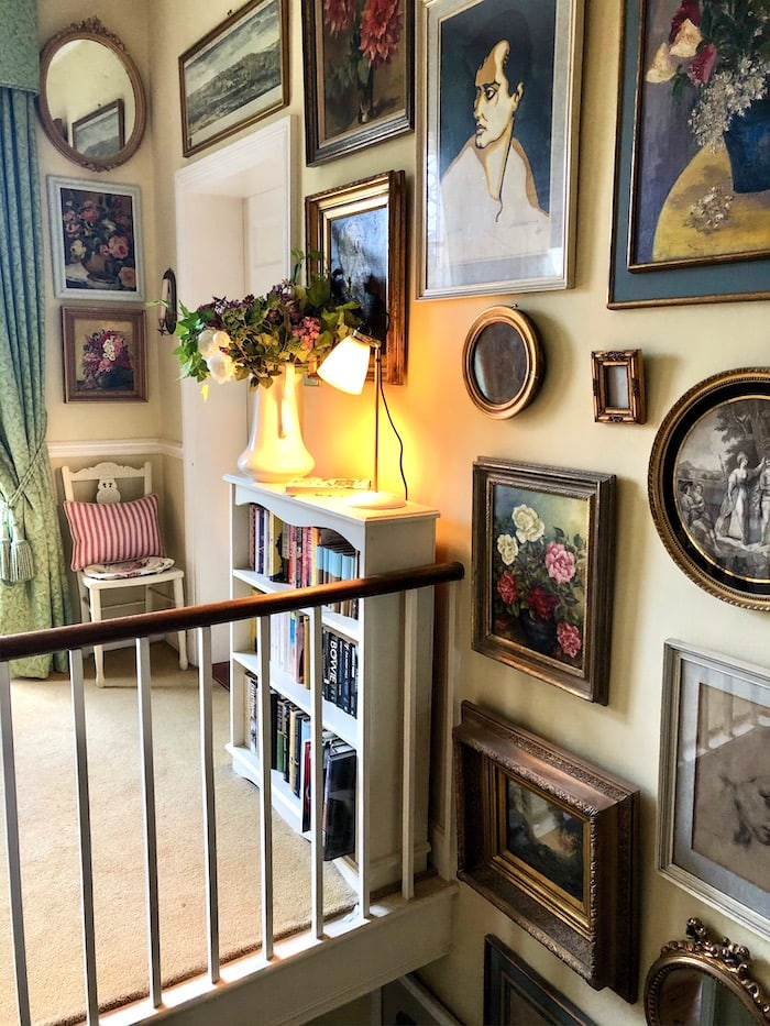 English country decor stairwell with paintings