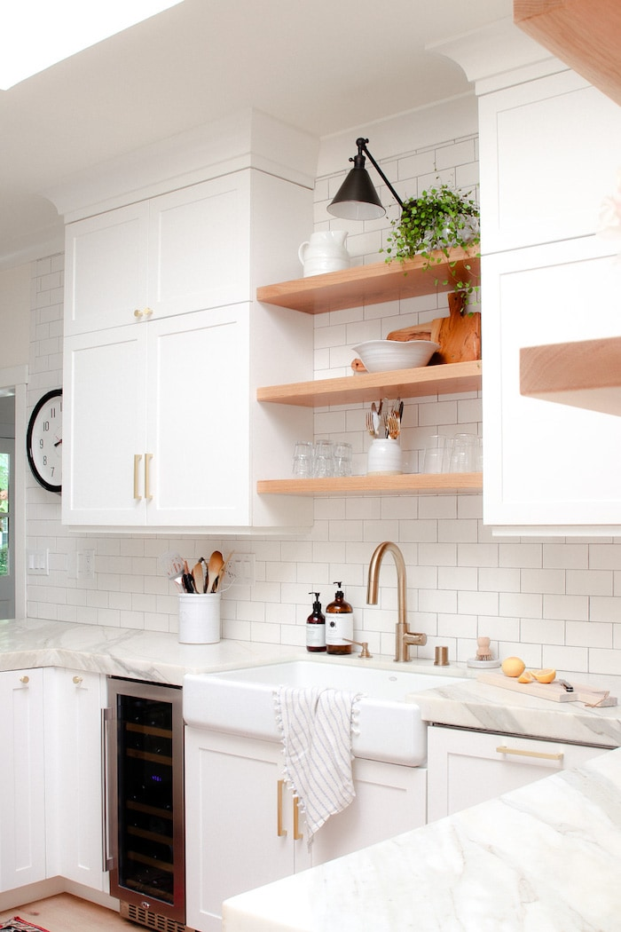 open shelving and white subway tile in a modern glam decor home