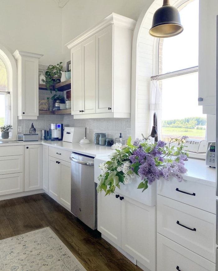 kitchen farmhouse sink with lilacs