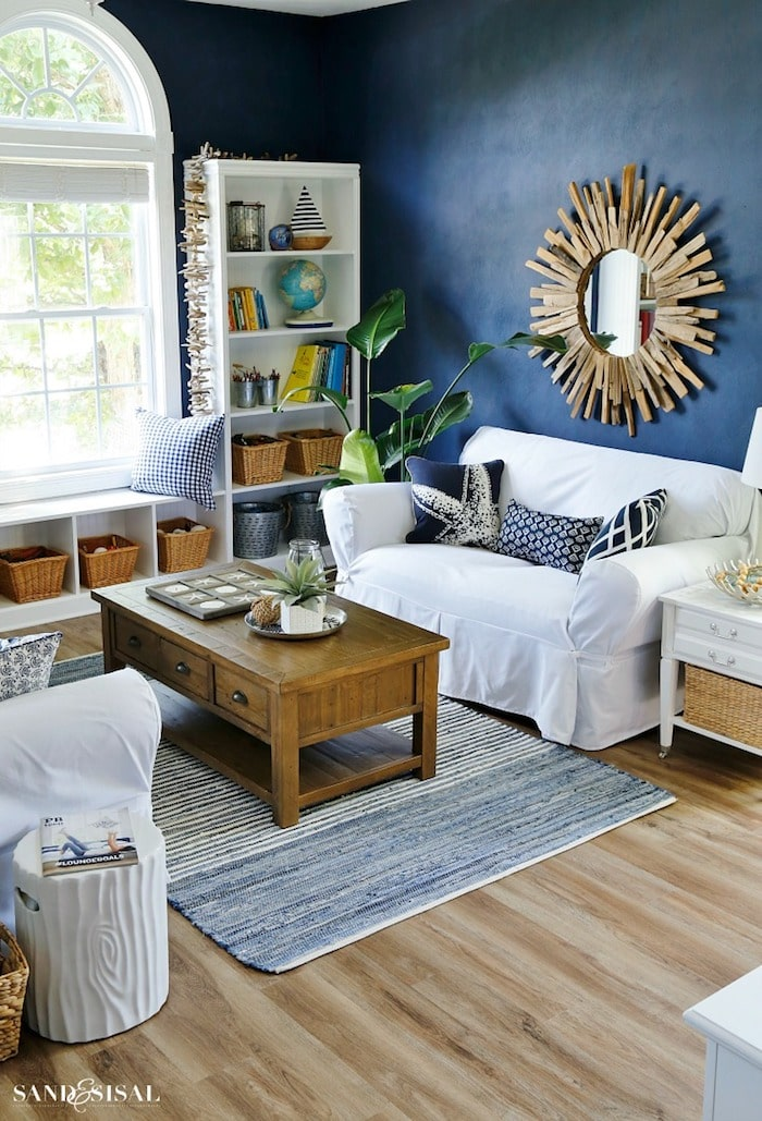 living room with white couch and navy blue walls