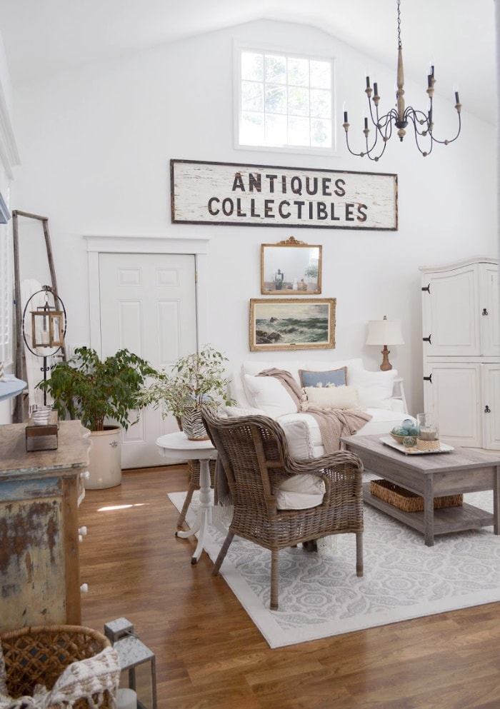 living room with tall ceiling and farmhouse style furniture