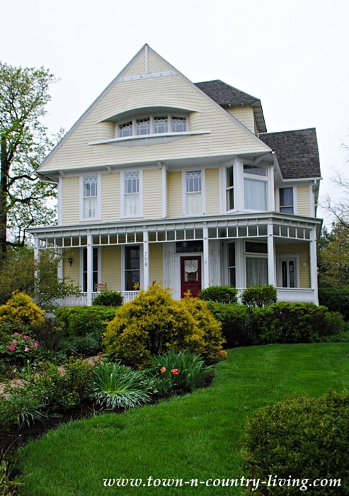yellow historic house with white trim