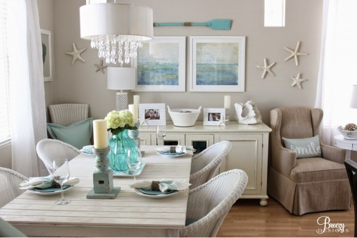 dining area with neutral walls and coastal decor