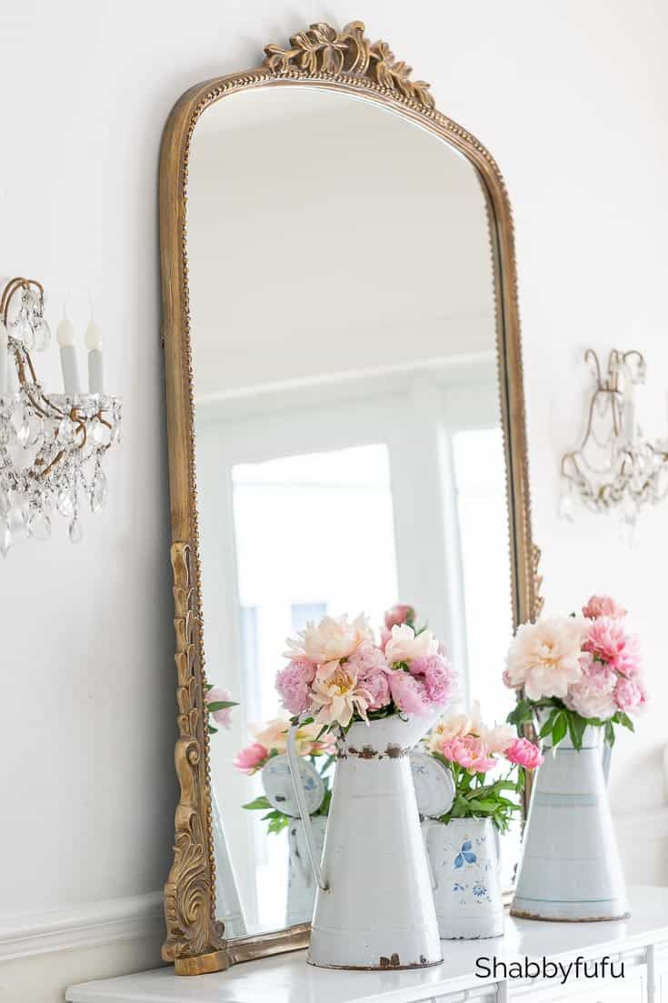 French style mirror on mantel leaning against wall