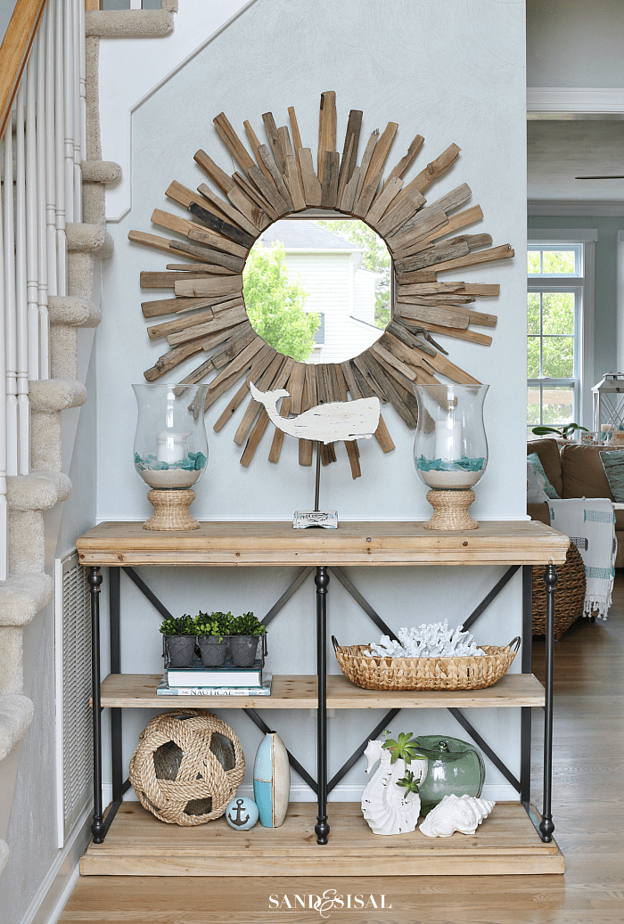 foyer wall with round mirror and console table with accessories