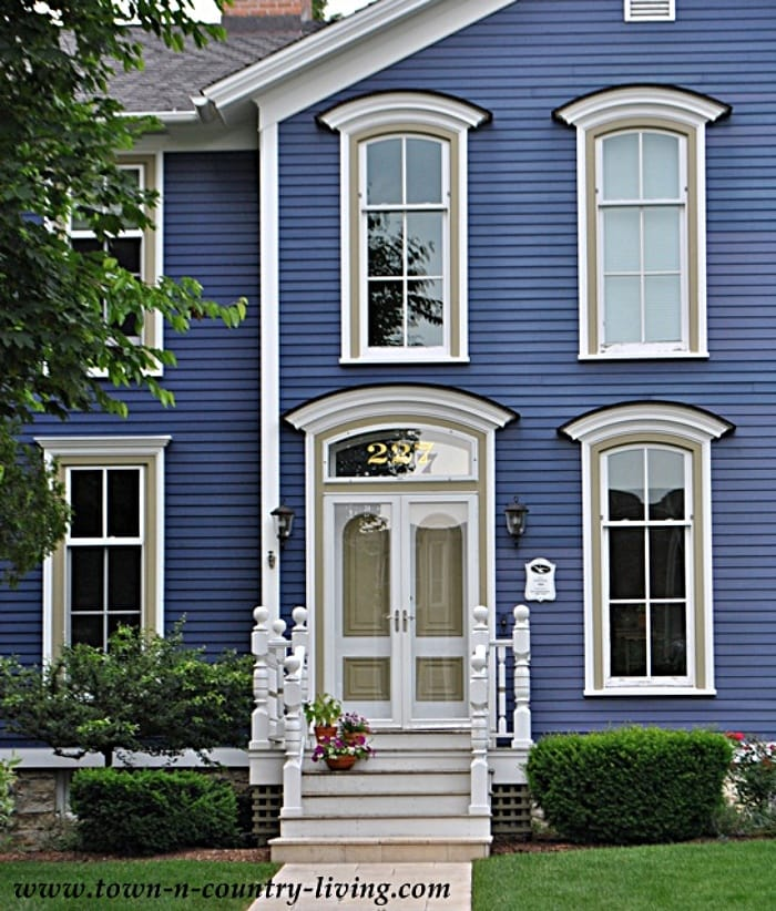 historic home with blue siding and white trim