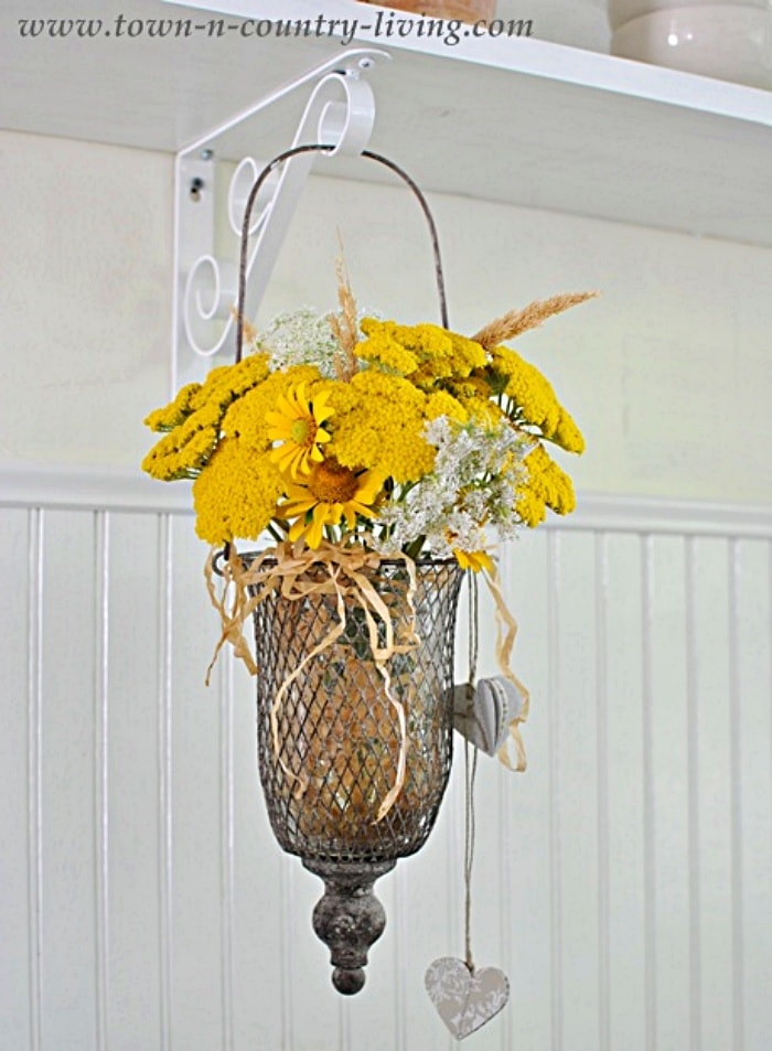 hanging basket filled with yellow flowers