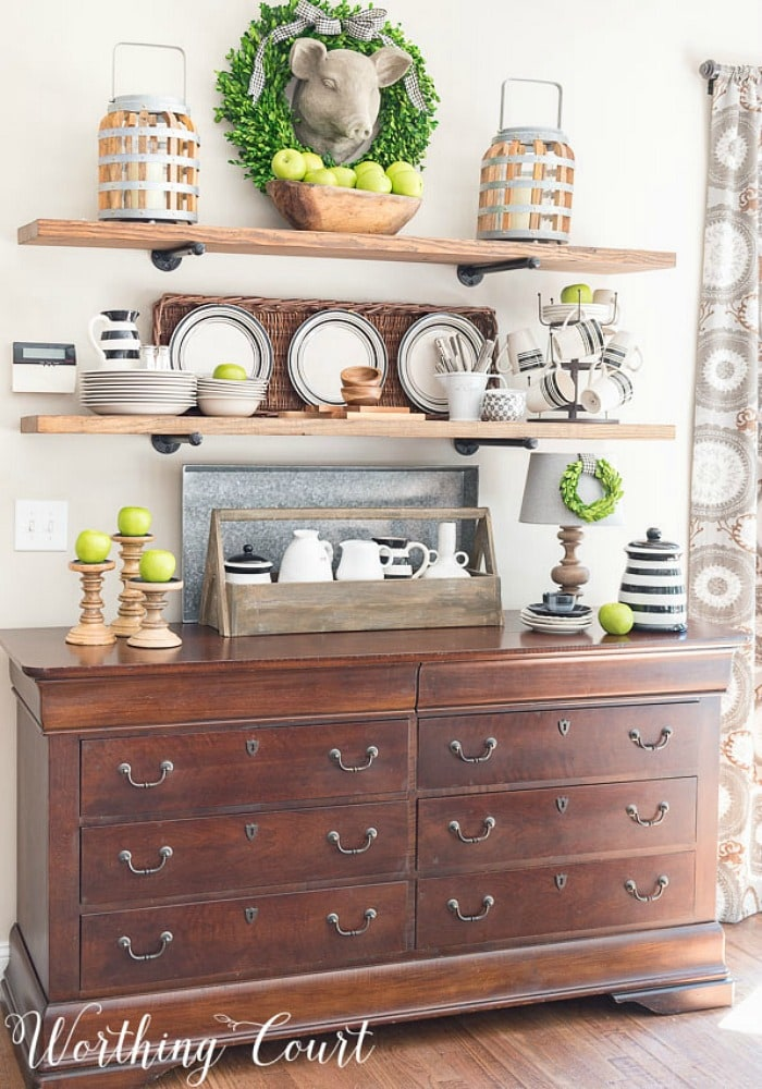 open shelves above sideboard with fall decorations
