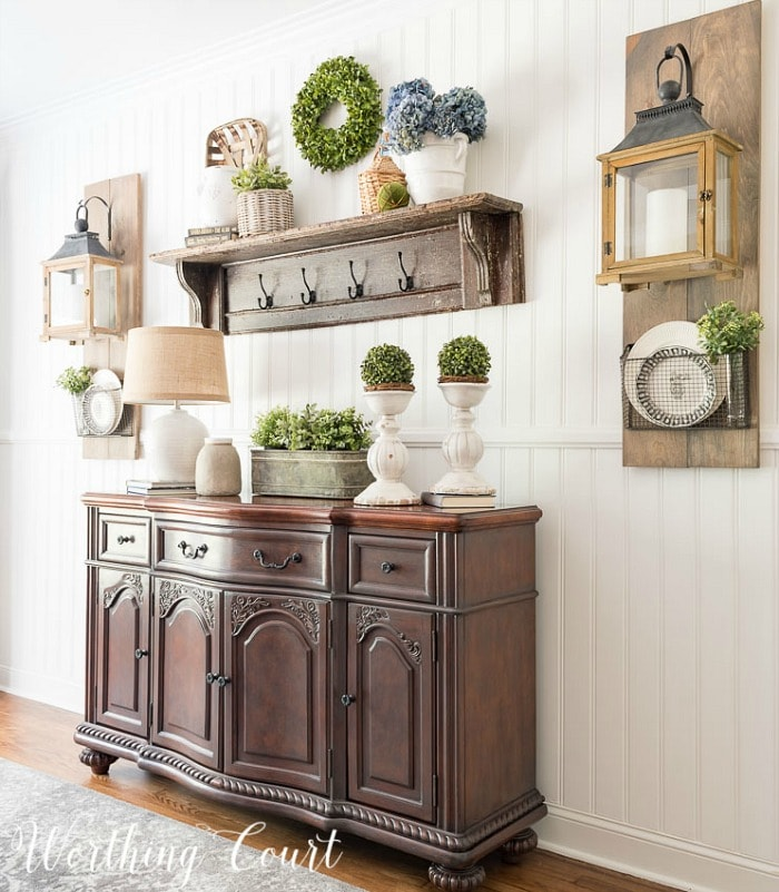 dining room side board with shelf above and decorative accessories