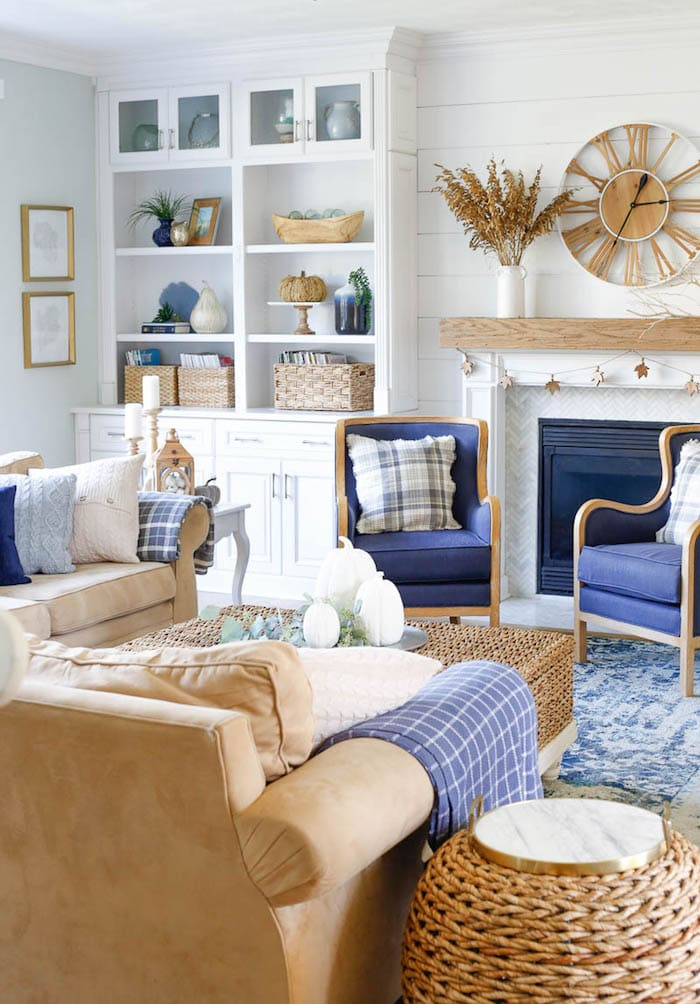 family room with 2 couches navy blue chairs and fall decor