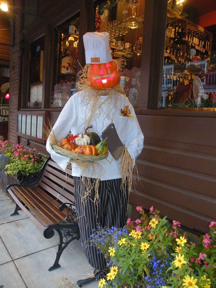 whimsical figurine of a person with a pumpkin head