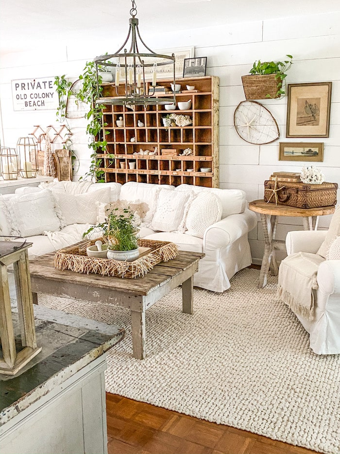 living room with white sofa, wood coffee table and farmhouse style decor