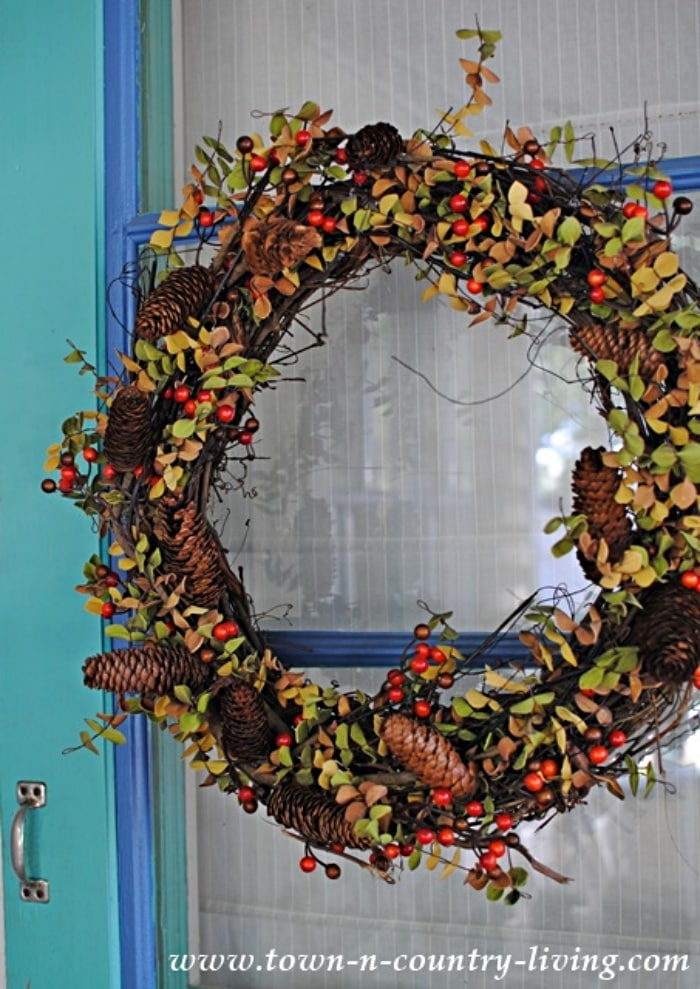 fall wreath hanging on a glass door