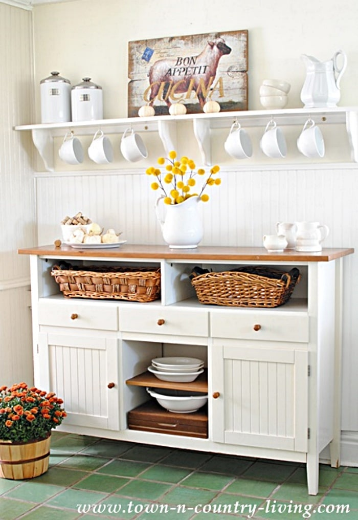 white kitchen sideboard with peg rack shelf above
