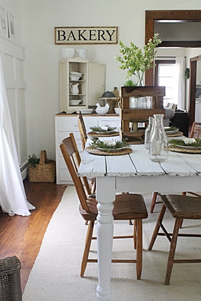 dining room with white farmhouse table and woodchairs