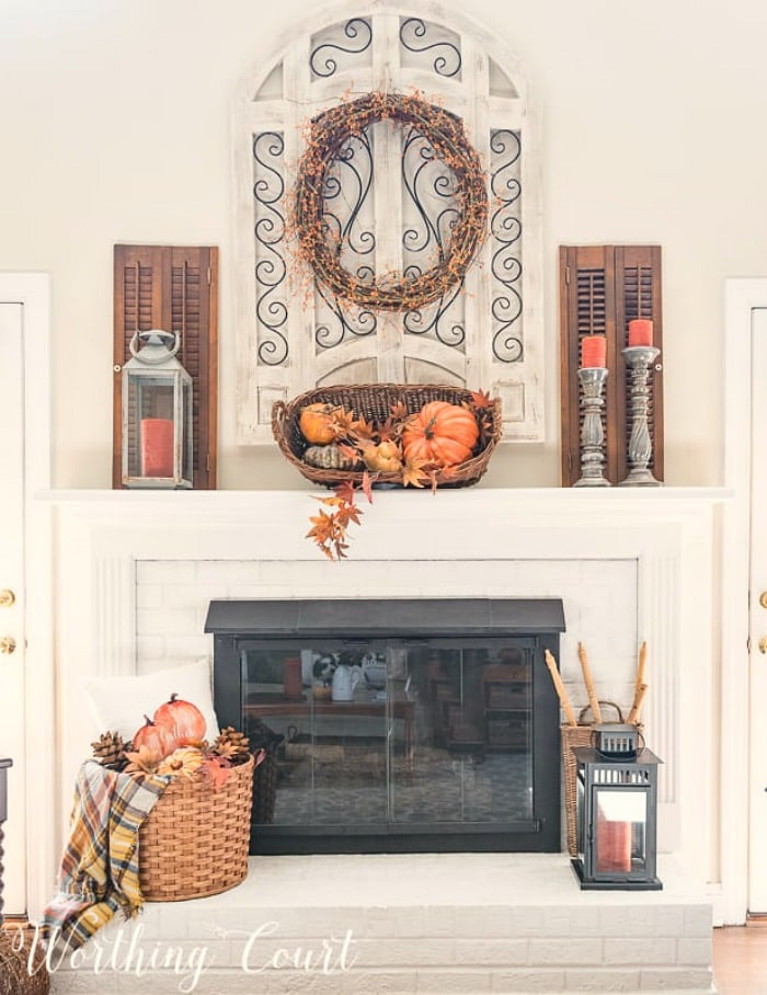 painted brick fireplace with fall decorations