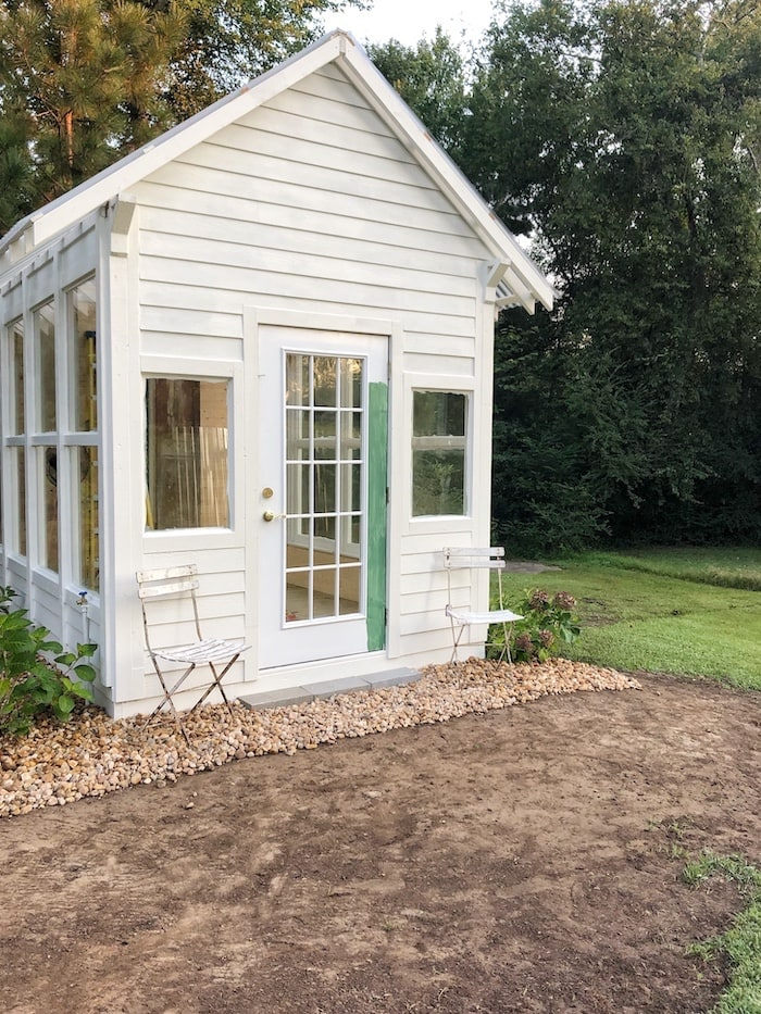 French farmhouse style home greenhouse