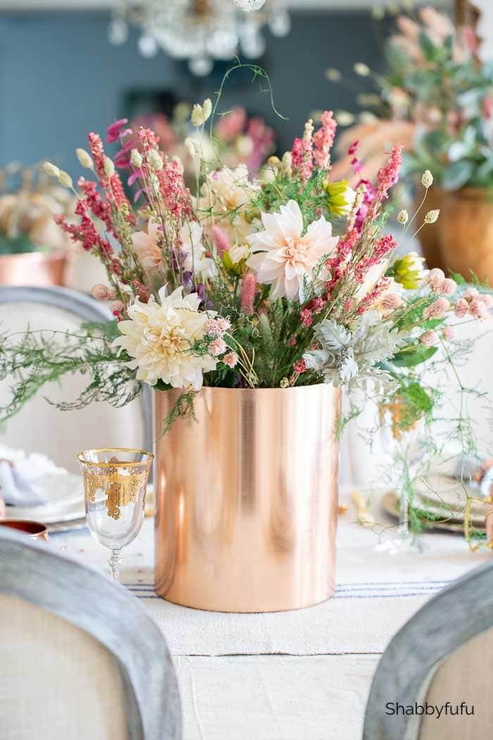 European rustic decor dried flowers in a copper bucket