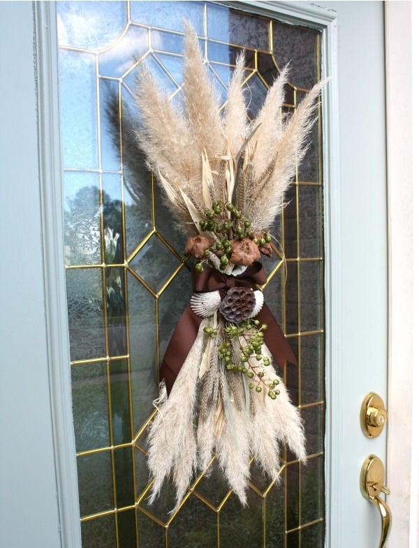 glass front door with a fall door swag