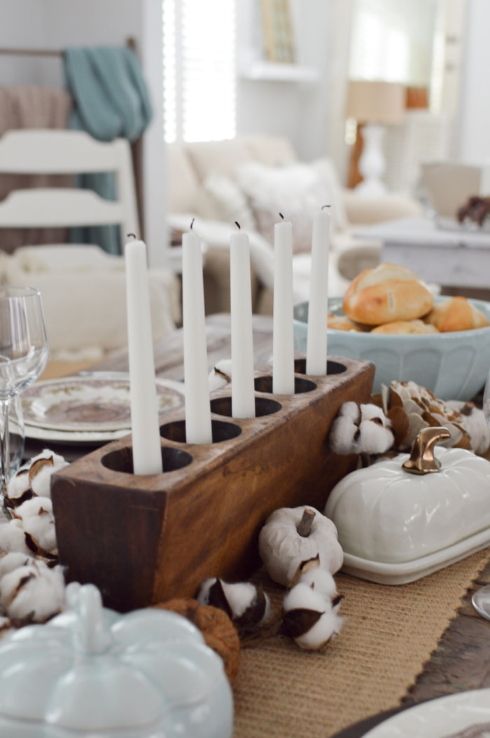 Thanksgiving centerpiece with white candles in a candle mold