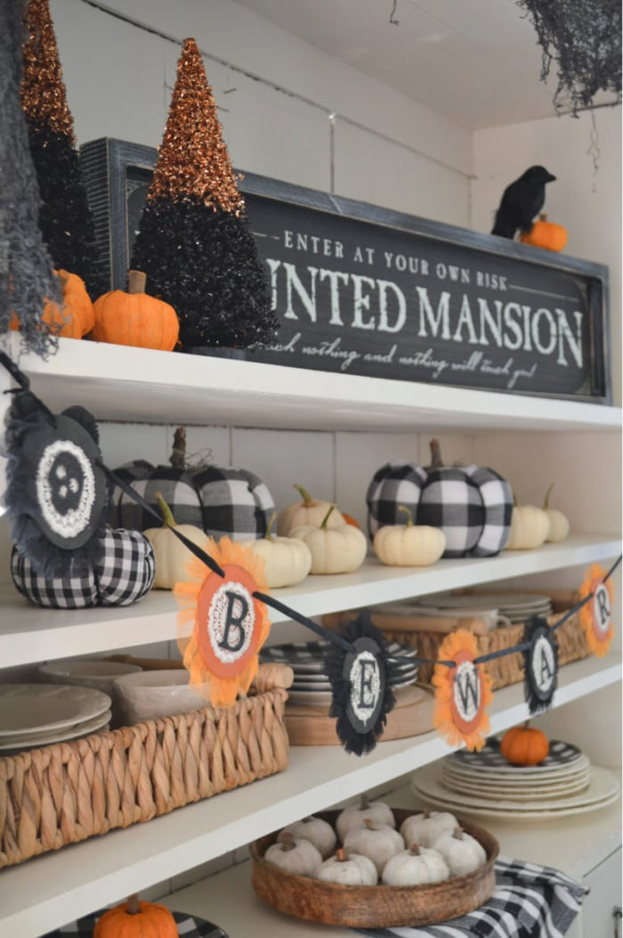 shelves with black, white and orange Halloween decorations