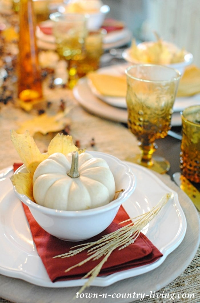 Thanksgiving table setting with white and amber dishware