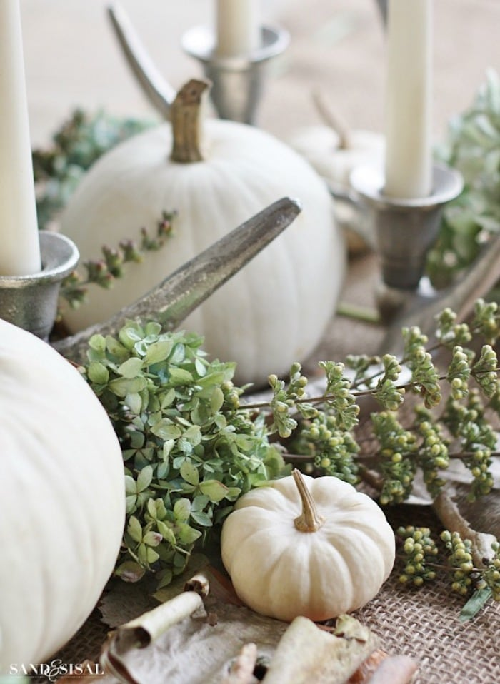 white pumpkins and greenery centerpiece