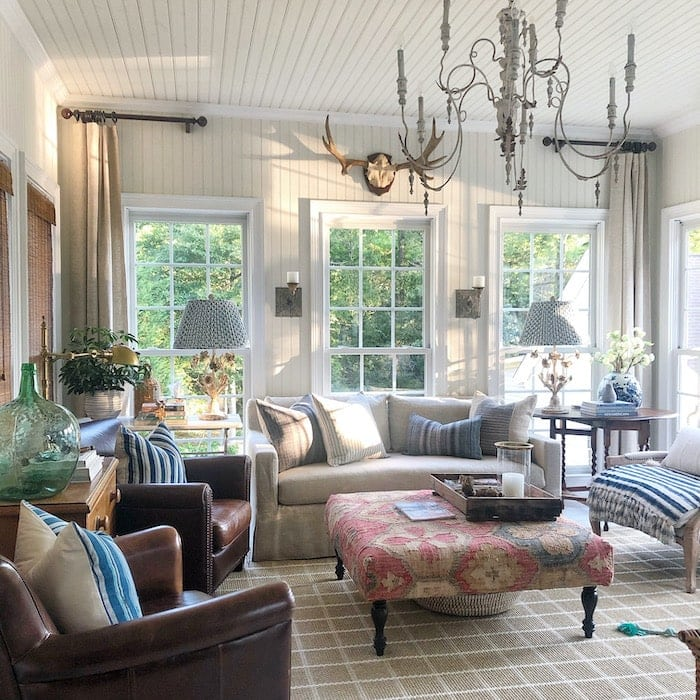 living room with French country style furniture and decor