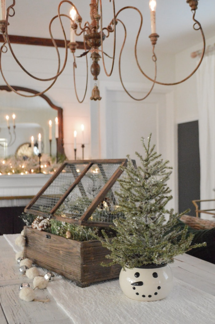 Christmas centerpiece with white and greenery