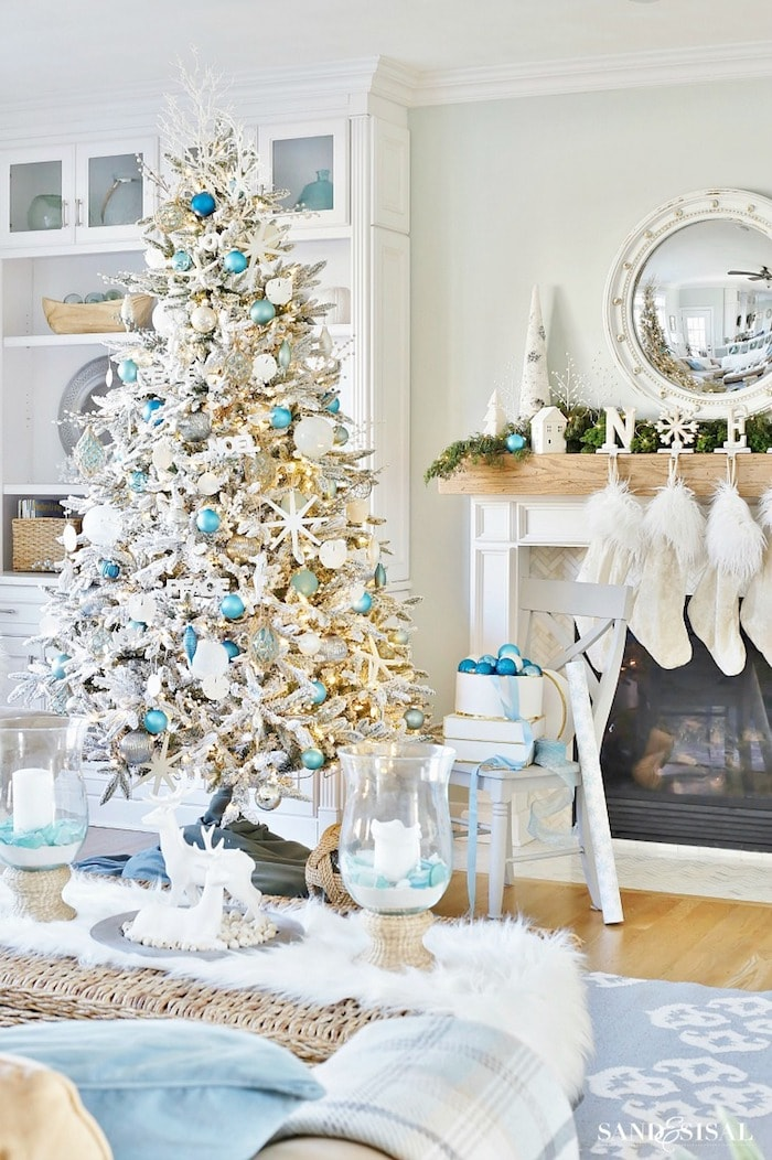 White Christmas tree and mantel with blue and white decorations