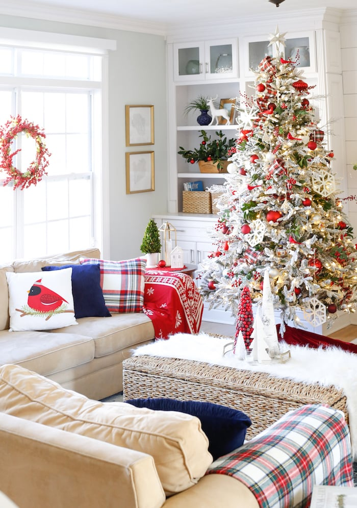 Living room with Christmas decor and a red and white Christmas tree