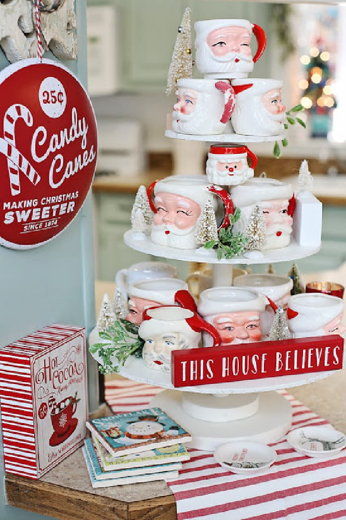 white tiered tray with display of Santa Claus mugs