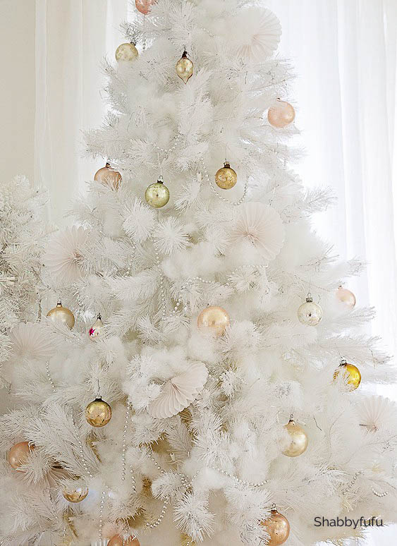 pink Christmas decorations on a white tree
