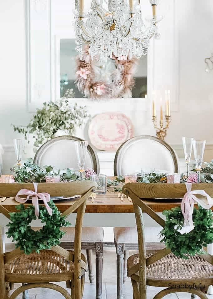 boxwood wreaths on chair backs