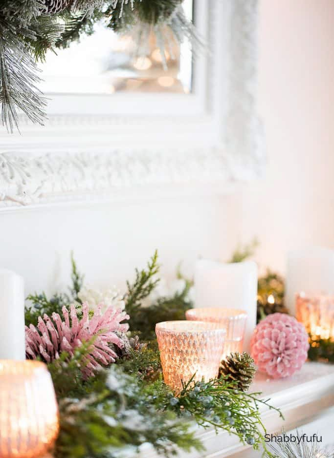 pink christmas decorations on a mantel