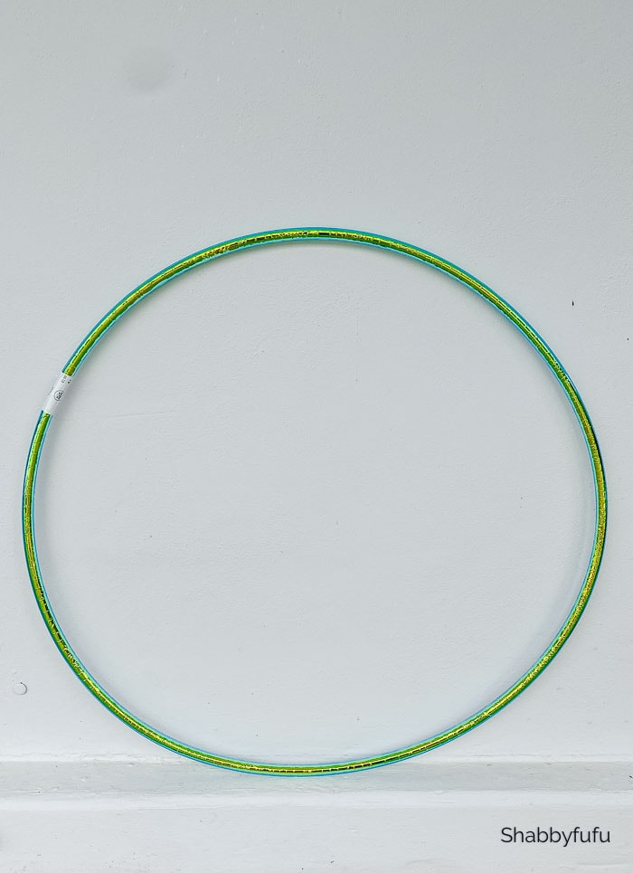 large flocked Christmas wreath with a hula hoop