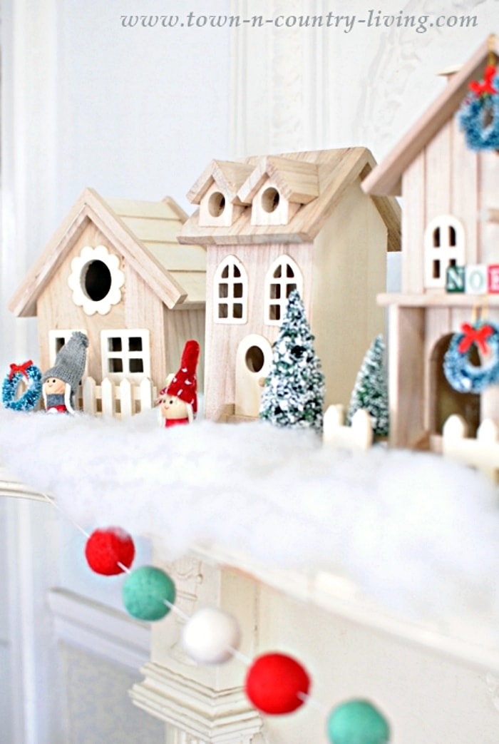 Christmas village houses on a fireplace mantel