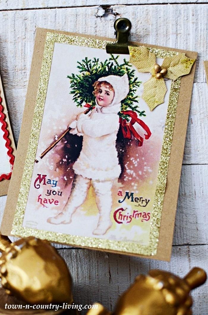 image of girl holding a Christmas tree on front of a Christmas card