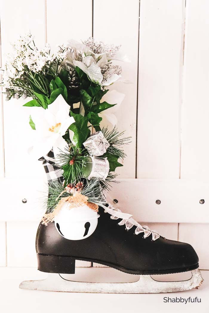 black ice skate with artificial flowers inside boot