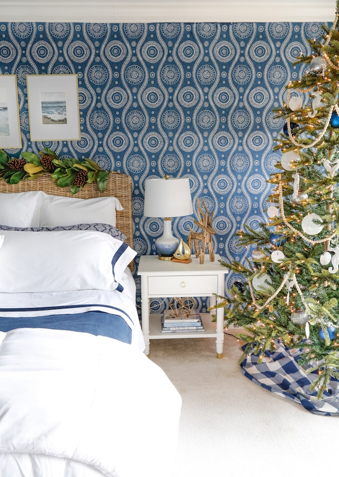 bedroom with blue and white wallpaper and a Christmas tree