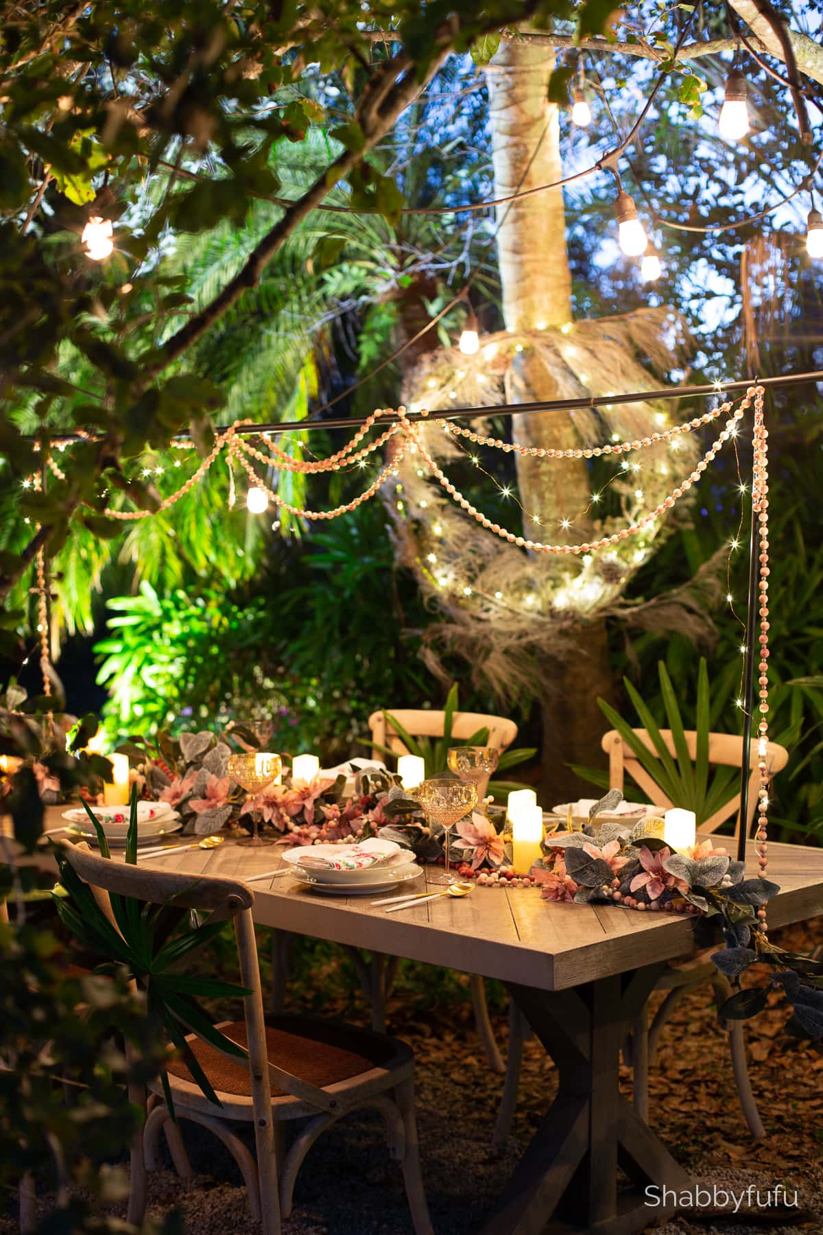 outdoor tablescape at night with lights and candles