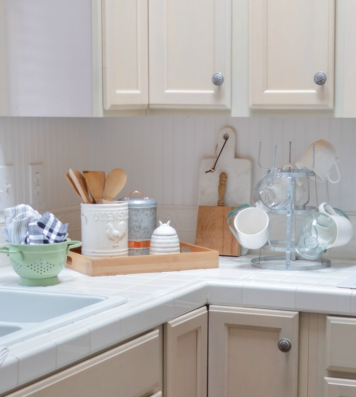 kitchen counter styling ideas with wood tray, cutting boards and a mug rack