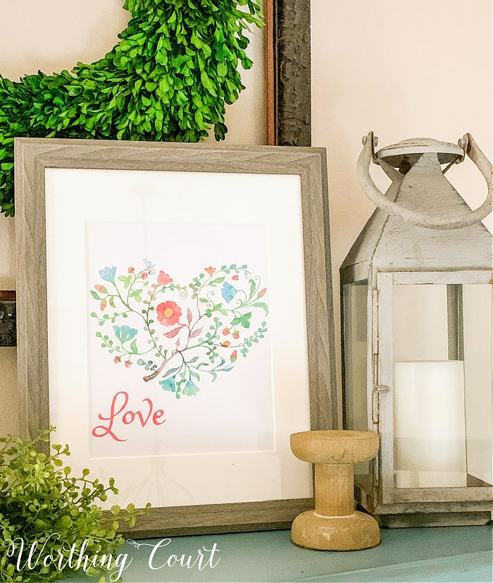 image of Valentine's Day printable in the shape of a heart with various colors and the word love