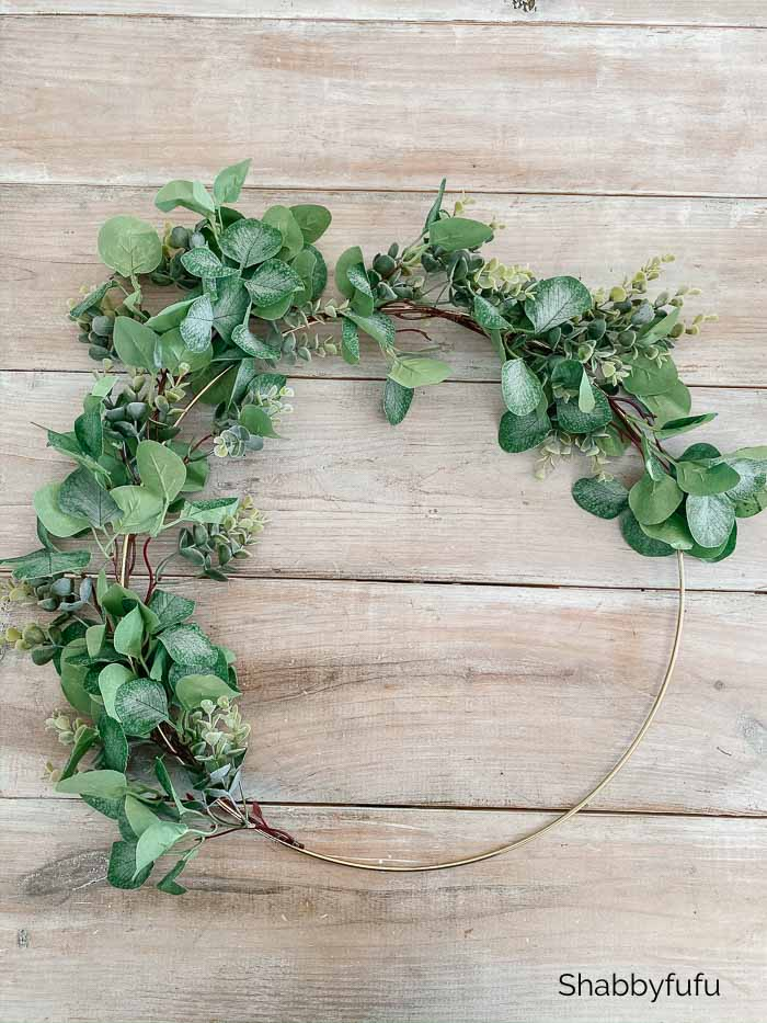 wreath made from a metal gold hoop with eucalyptus leaves attached
