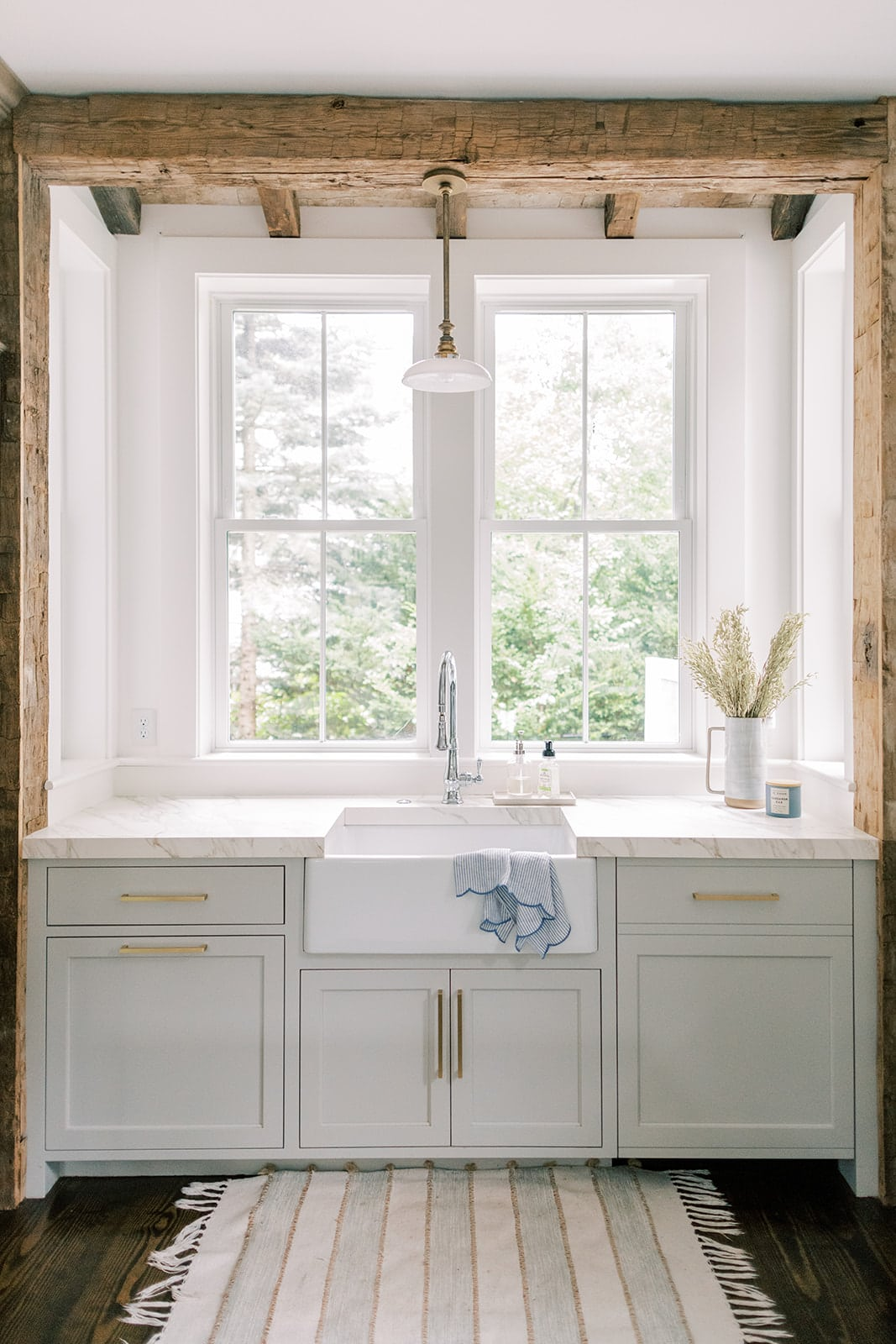 mixed metals on a farm sink New England home tour kitchen