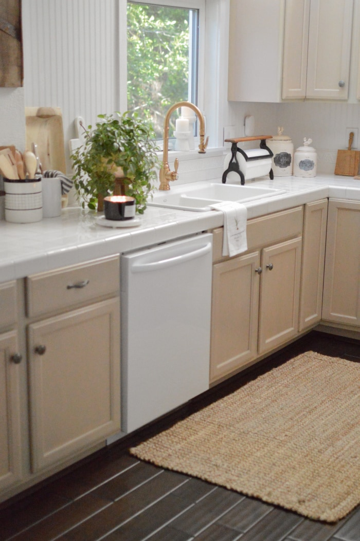 white kitchen sink with off white cabinets