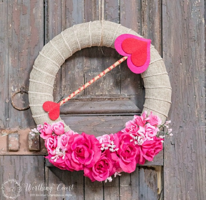 Valentine's wreath hanging on a wood shutter