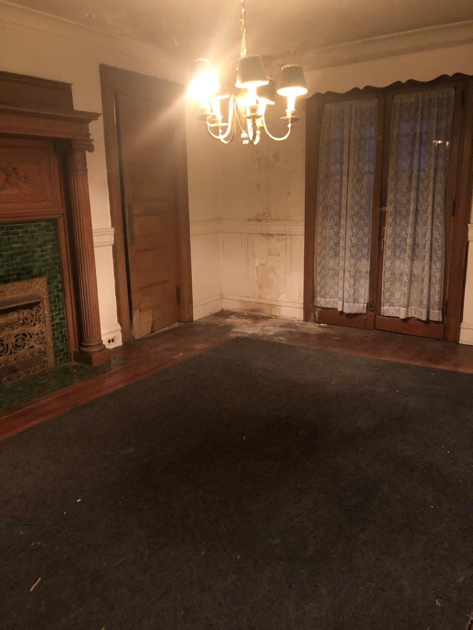 Dining room before with lots of neglect and damage