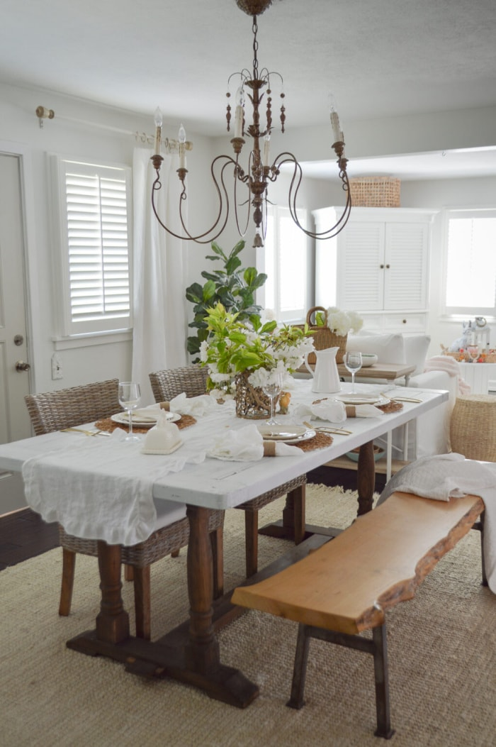 dining room table with white table cloth and an Easter tablescape